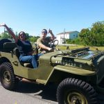 Cliff Tyndall and guest sitting in 1944 Army Jeep