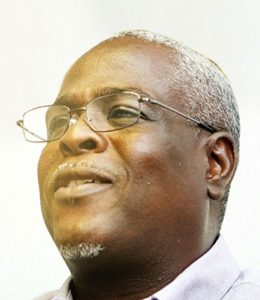 Reverend Dr. Dwight Cannon wearing white shirt and glasses