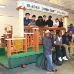 Students from East Bladen High School carpentry shop class on parade float