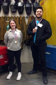 Sarah Allen and Ricardo Ramirez standing with SkillsUSA medals around their necks